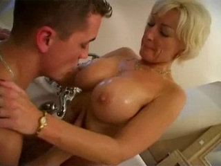 A mummy of years with fantastic body fucking in the bathtub of her son   bathroomson